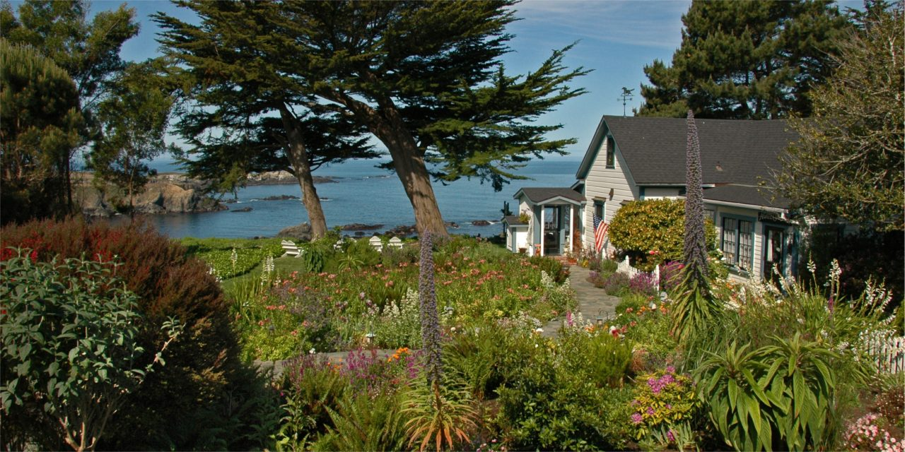 A view across the verdant gardens in front of the Agate Cove Inn, a frequent venue for Elope Mendocino weddings.
